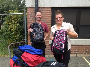 Pictured: Kelly Keil from the Back2School Outreach with Kevin Mitchell the custodian at School 12 receiving the 75 backpacks filled with school supplies from last years efforts. This year will be Schools 12's 3rd year participating with the Back2school Outreach. The project has provided 150 students with a free quality filled backpack for his/her school year.